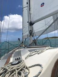 Our first day sail with the new sails and newly working engine.  We tucked in a reef very soon after this photo was taken